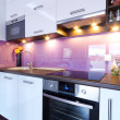 White and purple kitchen interior — Stock Photo #13974786