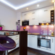 White and purple kitchen interior — Stock Photo #13974931