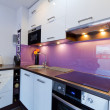 White and purple kitchen interior — Stock Photo #13974972