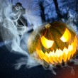 Stock Photo: Scary halloween pumpkin in dark forest
