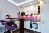 White and purple kitchen interior — Stok fotoğraf
