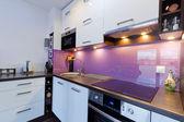 White and purple kitchen interior — Stock Photo