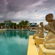 Fountain statues at the tropical swimming pool — Stock Photo #16324197