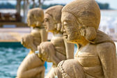 Fountain statues at the tropical swimming pool — Stock Photo