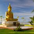 Statue of golden Buddha at the sea in Thailand — Stock Photo #16330235