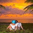 Watching together sunset under palm tree — Stock Photo #16330613