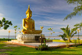 Statue of golden Buddha at the sea in Thailand — Stock Photo