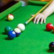 Stock Photo: Playing pool