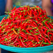 Stock Photo: Red chili peppers for sale