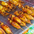 Grilled squids on local market — Stock Photo #16903381