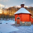 Cottage church in winter scenery — Stock Photo
