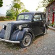 Stock Photo: Vintage car at Irish cottage house