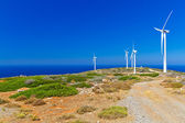 Wind turbines field over blue sky on Crete — Stock Photo