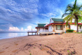 Oriental architecture holiday house on the beach — Stock Photo