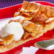 Piece of apple tart and cream — Stock Photo