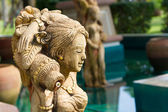 Oriental style fountain statues — Stock Photo