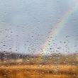 Royalty-Free Stock Photo: Rainbow through rained window