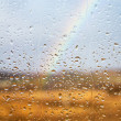Rainbow through rained window — ストック写真