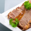 Slices of homemade roast pork - Stock Photo