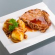 Roast pork with gravy and potatoes — Stock Photo