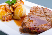 Roast pork with gravy and potatoes — Stock Photo