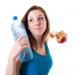 Young woman with bottle of water and apple — Stock Photo