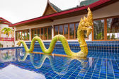 Golden dragon at entrance to Andaman Princess Resort & SPA. — Photo