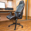 Office chair at the computer desk at home — Stock Photo