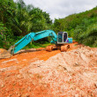 Digger in the tropical jungle — Stock Photo