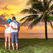 Watching together sunset under palm tree — Stock Photo