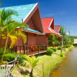Holiday houses on poles in Thailand — Stock Photo #22068279