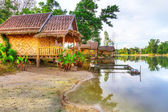 Small village at the water in Thailand — Stock Photo