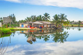 Holiday houses on poles in Thailand — Stock Photo