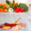 Stock Photo: Fridge full of healthy food