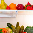 Fridge full of fruits and vegetables — Stock Photo
