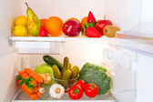 Fridge full of fruits and vegetables — Stock Photo