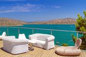 White sofas with Mirabello Bay view — Stock Photo