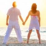 Romantic sunrise on the beach — Stock Photo