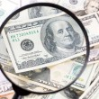 Dollar under magnifying glass — Stock Photo