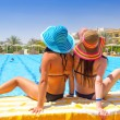 Relax on holidays at swimming pool — Stock Photo