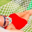 Beautiful woman relaxing on the hammock — Stock Photo