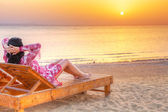 Beautiful woman relaxing at sunrise over Red Sea — Stock Photo