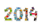 New Year 2014 sign with four seasons — Stock Photo
