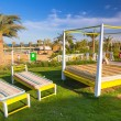 Sunbeds on the beach of tropical resort in Hurghada — Stock Photo