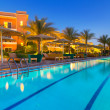 Swimming pool of tropical resort in Hurghada at night - Stock Photo