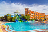 Slides at swimming pool of tropical resort in Hurghada — Stock Photo