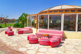 Red sofas at the tropical resort in Hurghada — Stock Photo