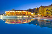 Swimming pool of tropical resort in Hurghada at night — Stock Photo