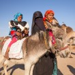 Native arabic family with donkey and goat - Stock Photo