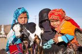 Native arabic family with donkey and goat — Stock Photo